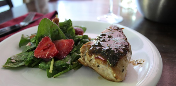 Spinach salad and pork chop